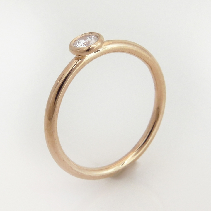 טבעת יהלום וזהב אדום